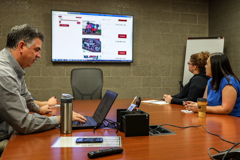 Titan Machinery Marketing team discussing campaigns and website content