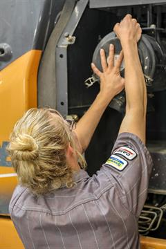 Female Service Technician doing a construction Uptime Inspection