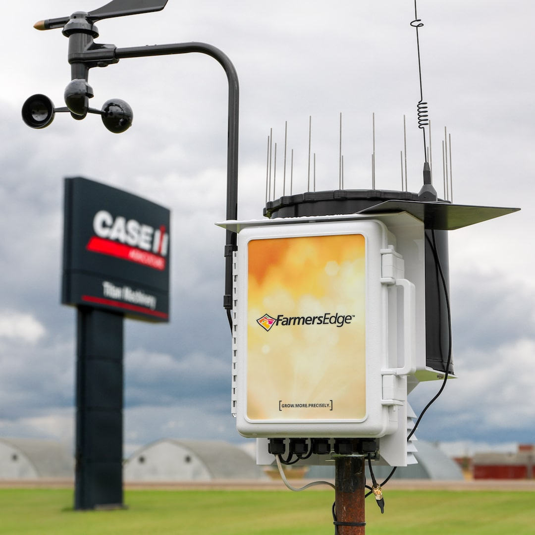 Farmers Edge weather station in front of Titan Machinery sign