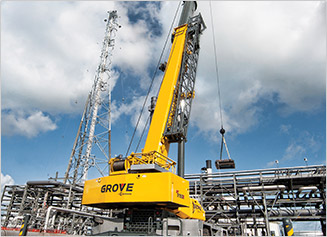 Grove Crane moving pieces at a job site